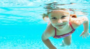Girl in an Inground Pool by Sunseekers